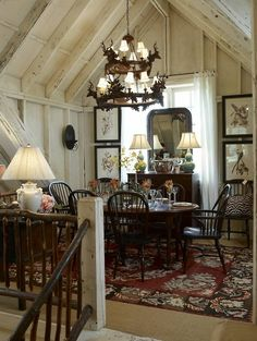 an elegant, rustic look - light walls and ceiling balance out the heavier table and area rug - Bring your design ideas to us and we'll work with you to create one of a kind reclaimed barn wood furniture for your home. www.braunfarmtables.com - showroom locations in Intercourse, PA and Bird in Hand, PA
