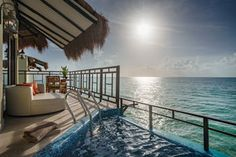 The Palafitos at El Dorado Maroma feature balconies and plunge pools
