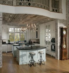Kitchen Design favorite! This floor color, possibly dark island with the white cabinets. Put the crystal chandelier in the dining room. Use the white with black streaks countertop for cabinets along the wall