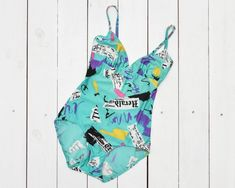 vintage one piece swimsuit low back low cut turquoise with black white pink violet yellow newspaper print Small size Black White Pink, Yellow, Newspaper Printing, Modest Swimsuits, Low Back, One Piece Swimsuit, Ready To Wear, Turquoise, Swimwear