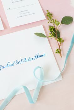 The Glass Box Raleigh wedding photos by Mikkel Paige Photography. Detail picture of blue hand calligraphy on the invitation envelope.