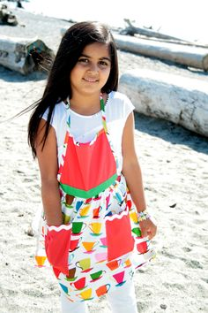 100% cotton fun and fashionable apron-frocks. Wash in cold and hang to dry for extended shelf life.