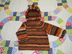 Baby Boy Autumn Hoodie. Adapted from Grammy's Favorite Knits for Baby. This book has several wonderful patterns that I made.