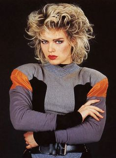 The fashion trends were influenced by the fashion industry and popular icons as women strove to recreate looks seen on their televisions. From Jane Fonda to Lady Di, the rich and famous of society has a big impact on the fashion trends of the decade. West London, Kim Wilde, Young Kim, Women Of Rock, 80s And 90s Fashion, Pop Singers, Hair Photo, Cute Faces, Big Hair