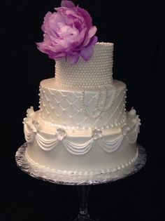 Tammy Allen Premier Wedding Cakes - Houston Cakes -  Three-tier wedding cake with pearl details and peony topper
