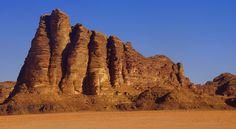 This is a shot of Seven Pillars of Wisdom Mountain in Wadi Rum, Jordan. - Nomadic Samuel Blog