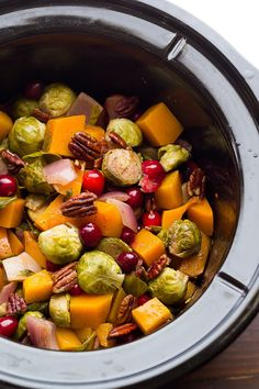 These slow cooker Brussels sprouts with butternut, pecans and cranberries are perfect for the holidays. Cook them in a slow cooker or on a sheet pan.