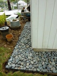 A rock maintenance strip around the house ... catches splashes, keeps walls clean and minimizes pests. Put your foundation plantings in front of the strip. Garden Therapy: Gardening!