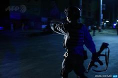 """""""An officer stands guard near the site of a suicide attack at the entrance to the Police Academy in Kabul """""""