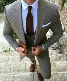 Something as simple as opting for a grey check three piece suit and a white classic shirt can potentially set you apart from the crowd. Rock a pair of dark brown leather double monks for a more relaxed feel.   Shop this look on Lookastic: https://lookastic.com/men/looks/three-piece-suit-dress-shirt-double-monks/24018   — White Dress Shirt  — Burgundy Tie  — White Pocket Square  — Dark Brown Leather Double Monks  — Grey Check Three Piece Suit
