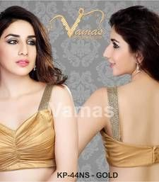 A very delicately rouched gold spagetti blouse with diamond enhanced lace on the spagetti stripes  Fabric Foil  Back Open