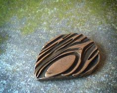 Woodland Blues handmade bronze guitar pick by RenataandJonathan - StyleSays