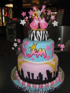 Totally Awesome Birthday Cake for a friend….. I was so excited to make this cake because the theme was the 80s cartoon, Jem and the Holograms!! I had to refresh my memory on Jem and it broug…