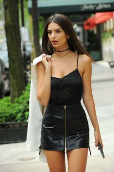 We love these pieces that fashion girls are buying this week.... This black cami top paired with a black zip-up leather skirt makes for the perfect street style look on Emma Ratajkowski