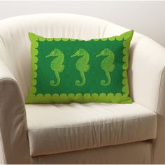 Seahorses in green Throw Pillow. Our seahorses in our lumbar pillow size in shades of greens. Our softly textured fabric is long-lasting, wrinkle-resistant and feels as great as it looks. Manufacturing time 7 business days plus shipping. Proudly made in the USA. Comes complete with faux-down fill.