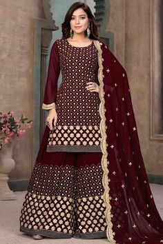 Gorgeously mesmerising is what you will look at the next social function by wearing this maroon georgette sharara suit which will be scene-stealing ethnic wear to shine in the spotlight. This round neck and full sleeve apparel adorned with zari and gota patti work. Teamed up with georgette sharara pant in maroon color with maroon georgette dupatta. Sharara pant has zari and gota patti work. #shararasuits #malaysia #Indianwear #weddingwear #andaazfashion Sharara Suit, Churidar Suits, Indian Attire, Indian Ethnic Wear, Pakistani Suits, Pakistani Salwar Kameez, Palazzo Suit, Palazzo Style, Pantalon Cigarette