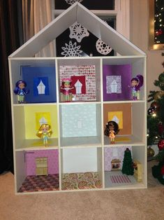 Home made doll house out of a cube bookshelf, roof was added and decor