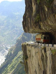 Yep.  That's a truck on a road squished between thoe two rocks . . .