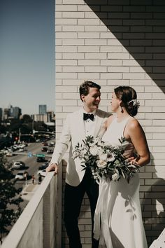 A couple looks over South Congress Avenue before their wedding ceremony at South Congress Hotel in Austin, Texas. Photo by Nikkolas Nguyen. Elegant Modern Wedding, Modern Minimalist Wedding, Modern Wedding Inspiration, Wedding Photography Inspiration, Candid Wedding Photos, Wedding Portraits, Bride And Groom Pictures, Groom Poses, Black Tie Wedding