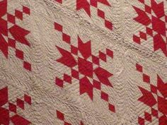 I do like 2-colour quilts..... very effective red & white and simple to figure out.
