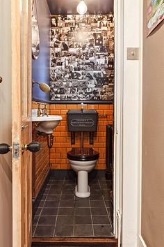 Space Gallery - Brighton: Old fashioned toilet by Thomas Crapper, walls decorated with a photo montage.