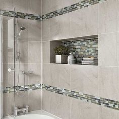 Details: Photo features Castle Rock 10 x 14 wall tile with Glass Horizons Arctic Blend 3/4 x Random mosaic as a decorative accent.