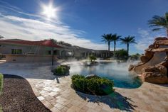 The Resort-Oasis Style backyard has a gigantic sparkling pool, water slide, spa, putting green, in-ground trampoline, multi-use sport court,a synthetic grass whiffle ball field perfect for the kiddos, and endless Mountain Views. Guess what former ball player lives here? Its for sale...