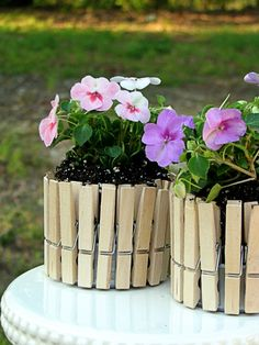 Mini Picket Fence Flower Pots from Big Bears Wife blog, love this idea and I want to make several and maybe paint some of them with light pastels and some leave plain. SOOOOO CUTE