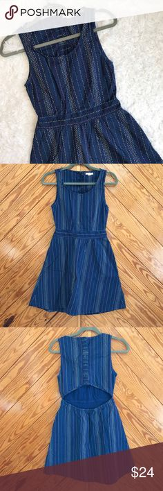 """Tulle Navy Cutout A line dress Tulle Navy Cotton Cutout A Line Dress. Navy with multicolor threading. Side pockets. In great condition - few minor snags on thread (see pic 5). Buttons in back can be undone. Measurements are taken laid flat and doubled: Length 34.5"""". Bust (armpit to armpit) 32"""". Waist 27"""". Back of waistband is elastic. ❌NO trades. Offers welcomed. Tulle Dresses Mini"""