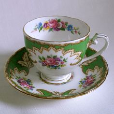 Royal Grafton Bone China. Green on white with floral decoration and gold trim