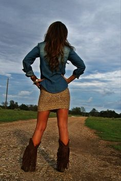 Denim shirt, sparkly mini skirt, and fringe cowboy boots