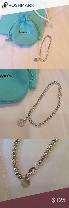 "Tiffany & Co. sterling silver bead bracelet. Tiffany & Co. sterling silver bead bracelet. Return to Tiffany & Co. Sterling silver charm with Tiffany blue enamel on back. Bracelet measures 7"" long. Beads are 4 mm. Tiffany & Co. Jewelry Bracelets"
