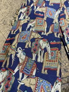 Mammoth design on burgundy Tie