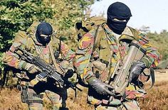 SFG operators on patrol. SFG - Special Forces Group - is the Land Component special forces unit of the Belgian Armed Forces. Members of the Special Forces Group are normally selected from the paracommando units of the Belgian Army. They must have at least four years experience as a paracommando to join the Special Forces Group.