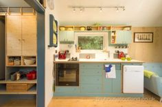 love the mix of wood and colors. kitchen shelving is fabulous!
