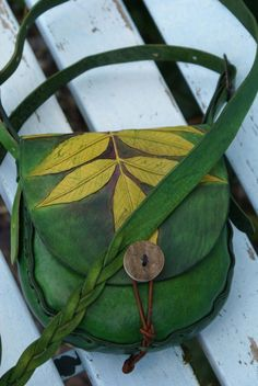 autumnal ash leaf hand carved on green leather Ogham bag with mystery braided strap - www.skyravenwolf.com