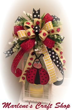 Welcome Spring /Summer with this whimsical Ladybug Lantern Swag / Lantern Bow. The Swag is pictured on a 20 in Lantern. The lantern swag features a wooden Lady Bug that was carefully handcrafted in my shop. I design my own templates and these are my original designs.  The bow features Four different ribbons including a fun black and white Polka dot print that adds some sparkle. There is a coordinating yellow check Ladybug print and a red animal print ribbon also. The bow is embelli...