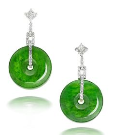 A fine pair of jadeite and diamond earrings Each formed as a lozenge set with a princess-cut diamond with a partial border of round brilliant-cut diamonds, suspending a series of articulated geometrically designed links set throughout with round brilliant-cut diamonds, terminating in a intense green jadeite hoop with good translucency, the diameter measuring approximately 23.6mm, carved with concave sides, the diamonds estimated to weigh approximately 1.35 carats in total, earring length…