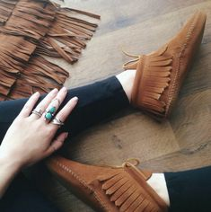 Christina of New Darlings rocks her turquoise rings along with her classic fringe boots