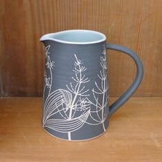 Horsetail. Detested by gardeners as a lot of weeds are, I love its architectural beauty. When I was little I would spend hours picking off the little sections of leaves (that come apart like Lego) one by one until I was left with a bare stem. #ceramics #stoneware #sgraffito #jug #pitcher #horsetail #ribwortplantain #wildplants #childhoodmemories