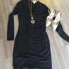 Black jersey Michael Michael Kors dress. This dress could not be more flattering. The since at the waist and the cowl neck are a 1-2 punch in that department. I bought this for a holiday party and only wore it once! MICHAEL Michael Kors Dresses Long Sleeve