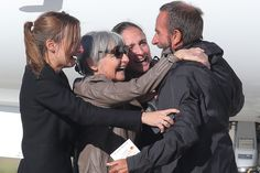 BACK HOME: Released French hostage Daniel Larribe, right, hugged his wife and two daughters outside Paris on Wednesday. Four French hostages...