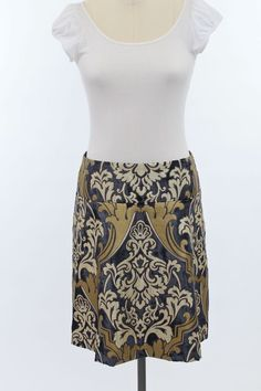 The Antique Paisley Navy brings a lot of texture to the table. It is great for play or evening wear.  Looks great paired with black, ivory, mustard yellow, and white.  Dynamite with metallic pumps, casual and funky with brown casual boots, and sharp with black dress boots.  It is a lightweight veleor print that is fun to wear summer nights with a tank or holiday party in the winter.  It is fully lined.