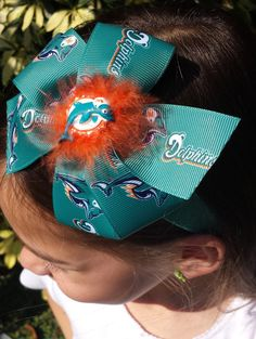 Hey, I found this really awesome Etsy listing at https://www.etsy.com/listing/228558351/miami-dolphins-glitter-headband-with