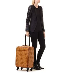 A heritage in travel goods and luggage makes the MCM Cabin Travel Trolley an ideal companion for stylish travel.