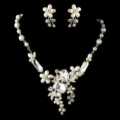 This beautiful floral design necklace and earring set are adorned with sparkling rhinestones and freshwater pearls. Designed in a wonderful floral setting with various sizes of stones and pearls, this lovely and exquisite necklace and earring set will complement any wedding grown and wedding inspired look.