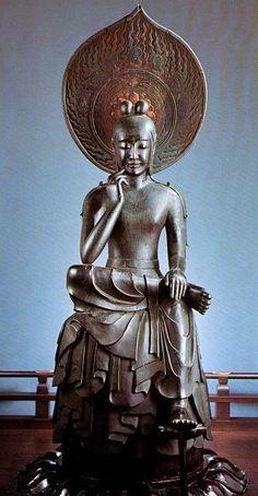 奈良 中宮寺 弥勒菩薩半跏思惟像 Thecamphor woodstatue ofMirokuis aNational Treasuredating from theAsuka period. Formerly painted, it is finished inlacquer.