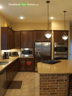 Island #kitchen features granite countertops and stainless steel #appliances.