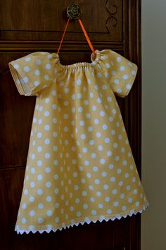 http://www.sew-much-ado.com/2012/01/infant-peasant-dress-free-pattern-and.html