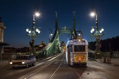 Budapest at Christmas - LEDs Transform Speeding Trains Into Electric Light Paintings Visit Budapest, Budapest Hungary, Places Around The World, Oh The Places You'll Go, Budapest Christmas, Liberty Bridge, Long Exposure Photos, Christmas Train, Futuristic Cars